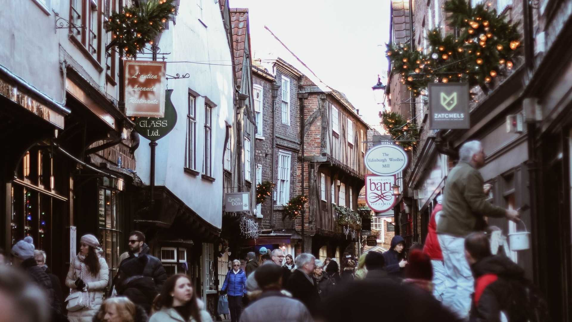 A crowd of people walking through york high street.
